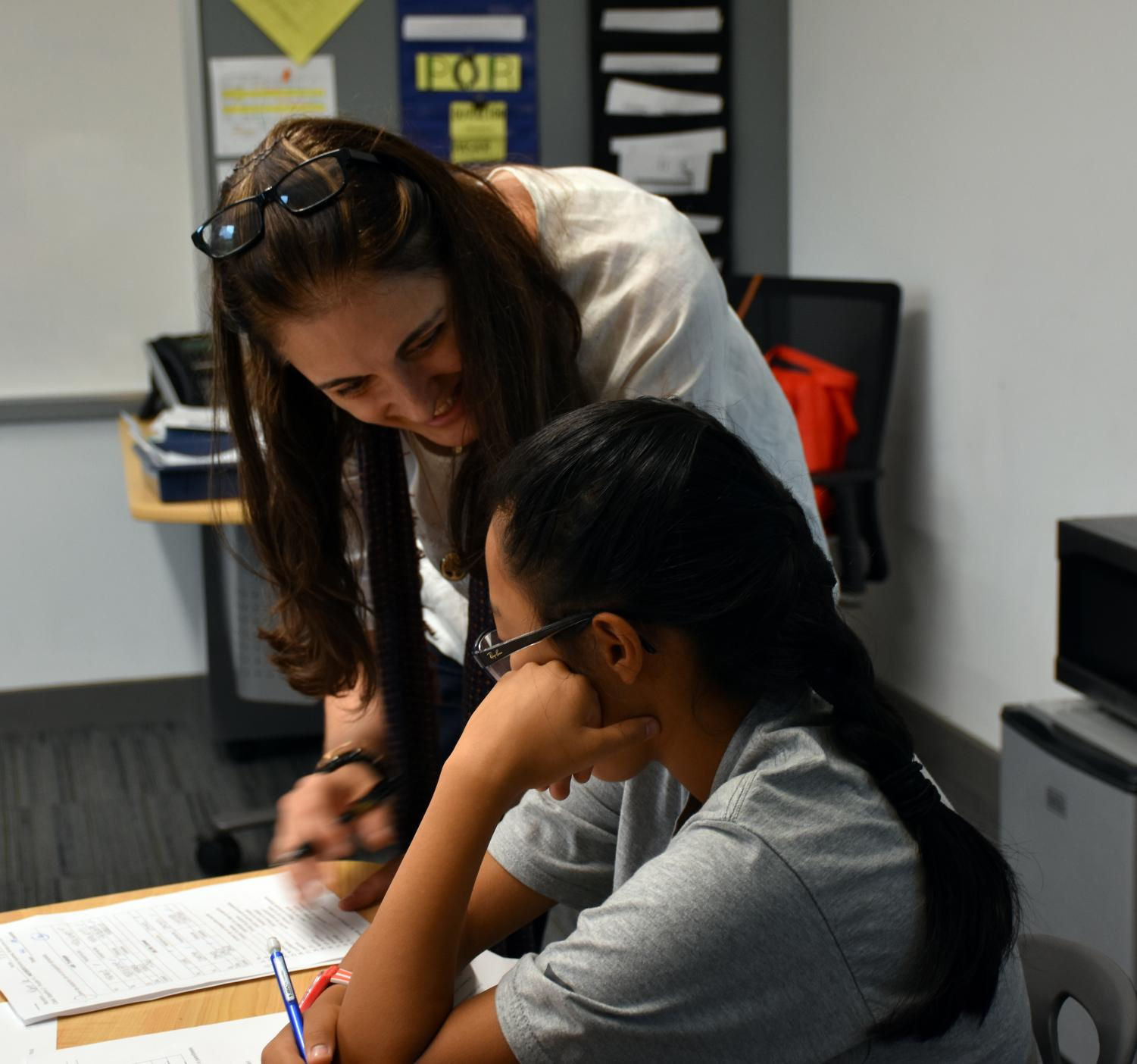 Soledad Moras, the new Spanish 2 teacher, helping one of her students.