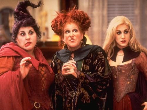 Hocus Pocus's three famous witches, the Sanderson sisters, strike a pose.
